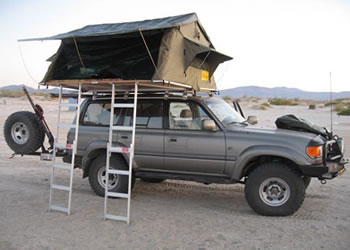 Land cruiser with a family Tent