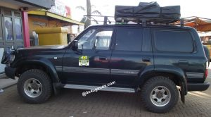 Diesel Land Cruiser VX with a Top Tent